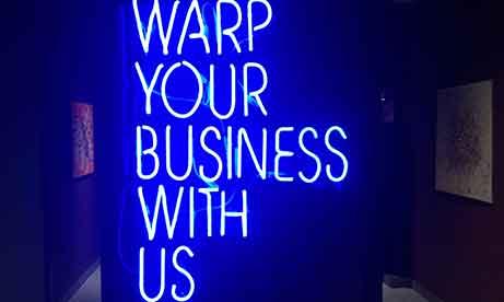 """Неоновая надпись """"WARP YOUR BUSINESS WITH US"""" в """"Креативный квартал"""" (CQ) в БЦ """"Астарта"""" (миниатюра)"""